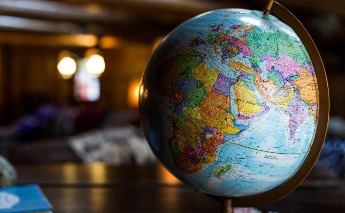 Globe photo by Kyle Glenn Unsplash